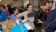 Filming cheetah undergoing health check before being released back into the wild. Cheetah Conservation Fund. Namibia (c) David Cayless