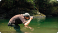 Photographing in river in Borneo.